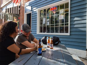 Customers have a drink outside the recently reopened Linda's Bar and Grill on Franklin Street on Tuesday, Oct. 27, 2020.