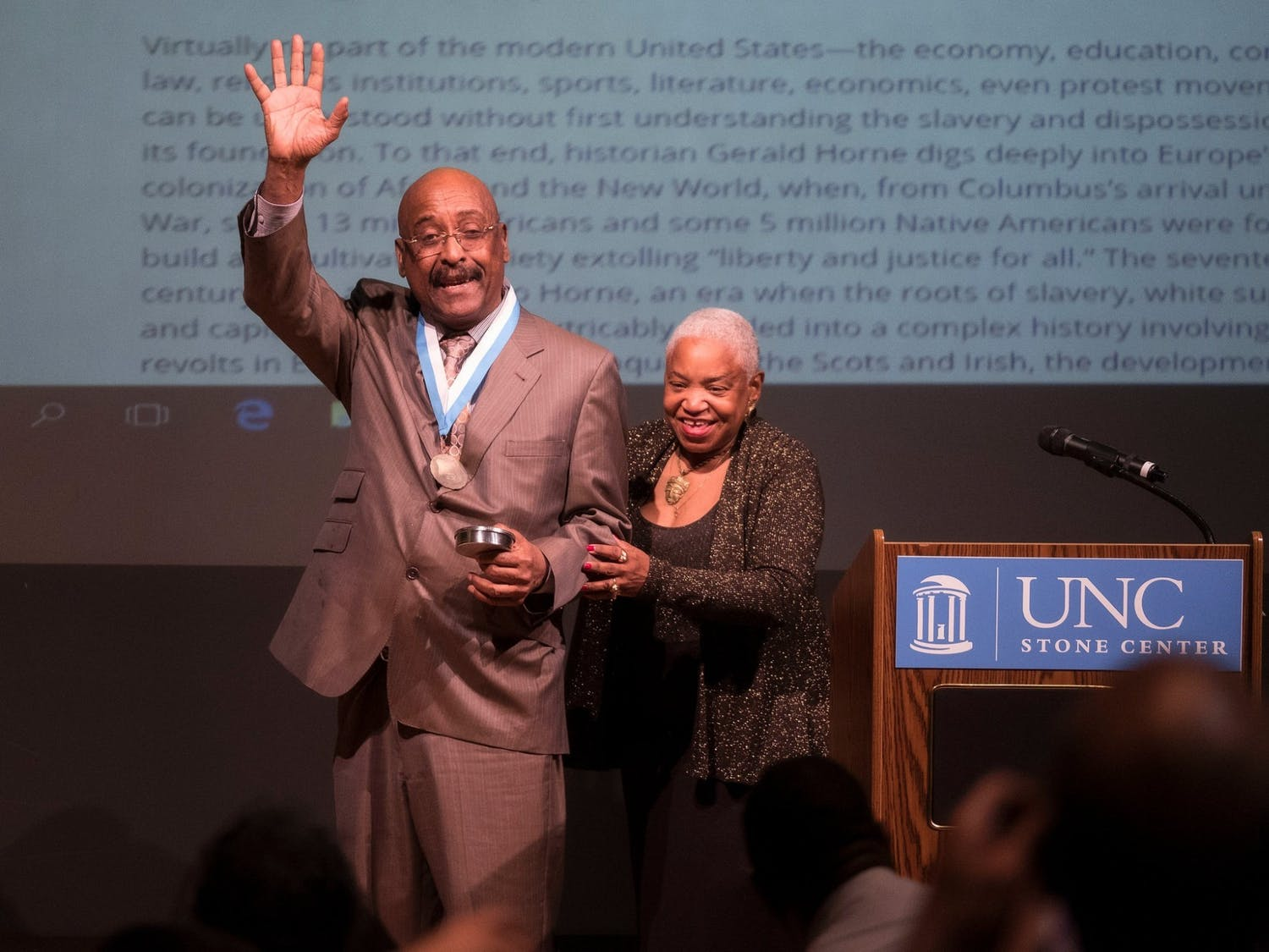 Professor Genna Rae McNeil accompanies Professor Colin Palmer as he receives the Award for Scholarly Distinction at the University of North Carolina, Chapel Hill, in 2018. Photo courtesy of Jon Gardiner.