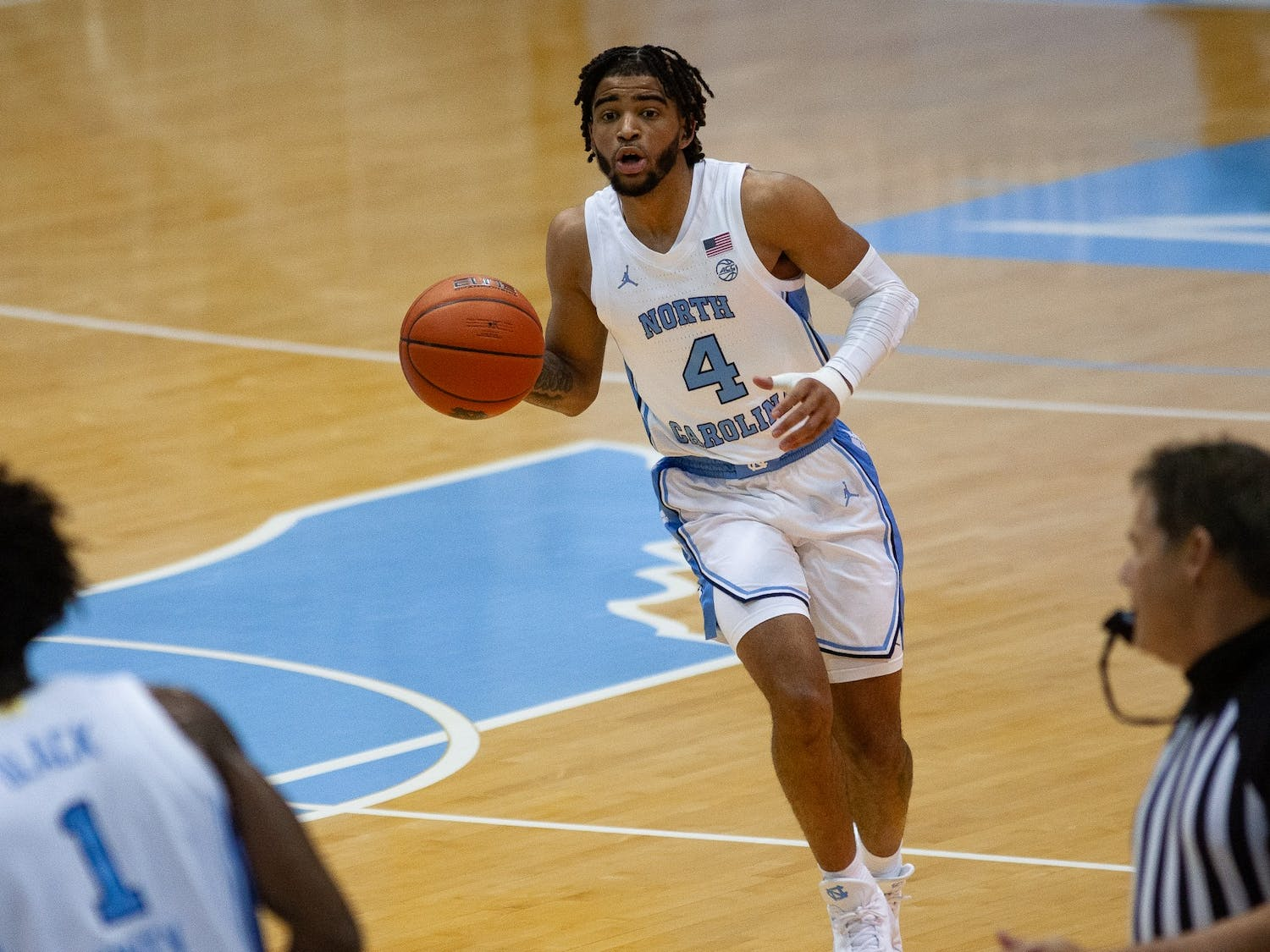 UNC first year guard RJ Davis (4) yells to a teammate during a game against N.C. Central in the Smith Center on Saturday, Dec. 12, 2020. UNC beat N.C. Central 73-67.