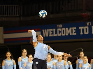 UNC Graduate Outside Hitter Nia Parker-Robinson (18) serves the ball during warmups before the Tar Heels' Aug. 28 matchup with Southern Methodist University Volleyball in Dallas, Texas. Photo Courtesy of UNC Athletic Communications.
