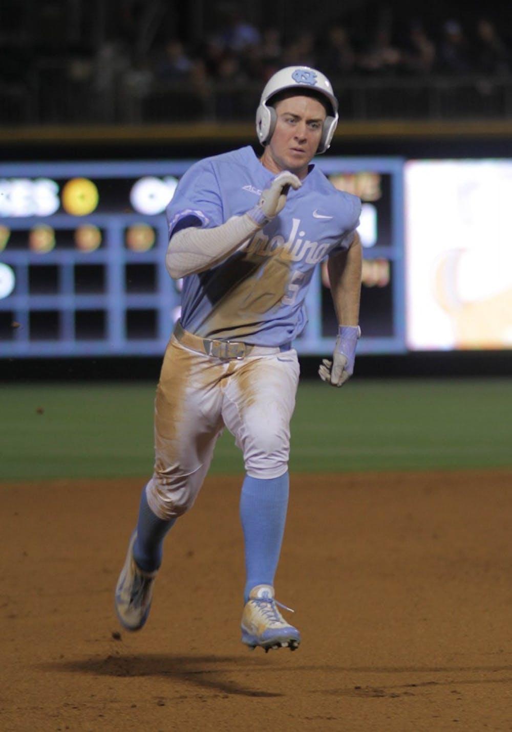 <p>Junior Brian Miller (5) bolts towards home base in UNC baseball's 20-5 win over South Carolina.&nbsp;</p>