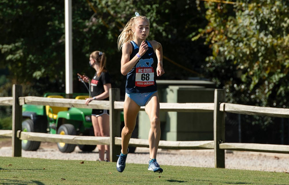 <p>First-year Sasha Neglia runs during the Wolfpack Invite in Cary, N.C. on Wednesday, Oct. 7, 2020. Photo courtesy of Jeffrey A. Camarati.&nbsp;</p>