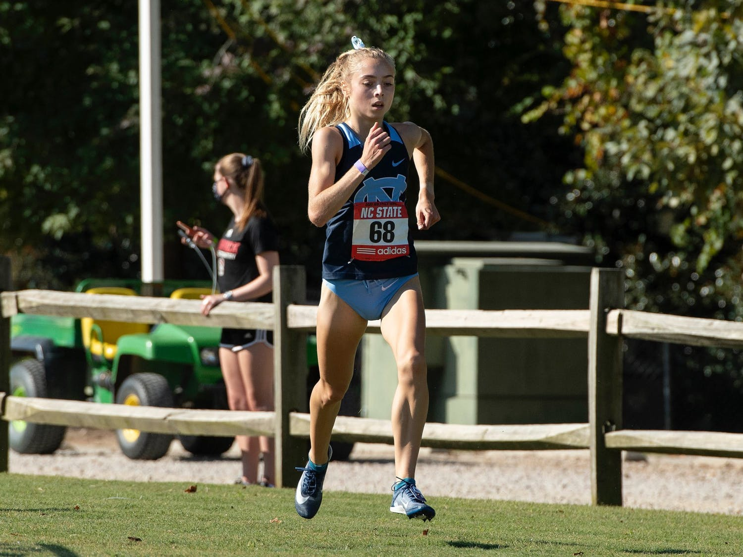 First-year Sasha Neglia runs during the Wolfpack Invite in Cary, N.C. on Wednesday, Oct. 7, 2020. Photo courtesy of Jeffrey A. Camarati.