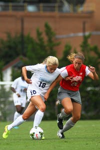 UNC midfielder Megan Buckingham (18) tries to create space between herself and Ohio State midfielder Sydney Dudley (26).  Buckingham would go on to score the game-winner for the Tar Heels in their 1-0 win.