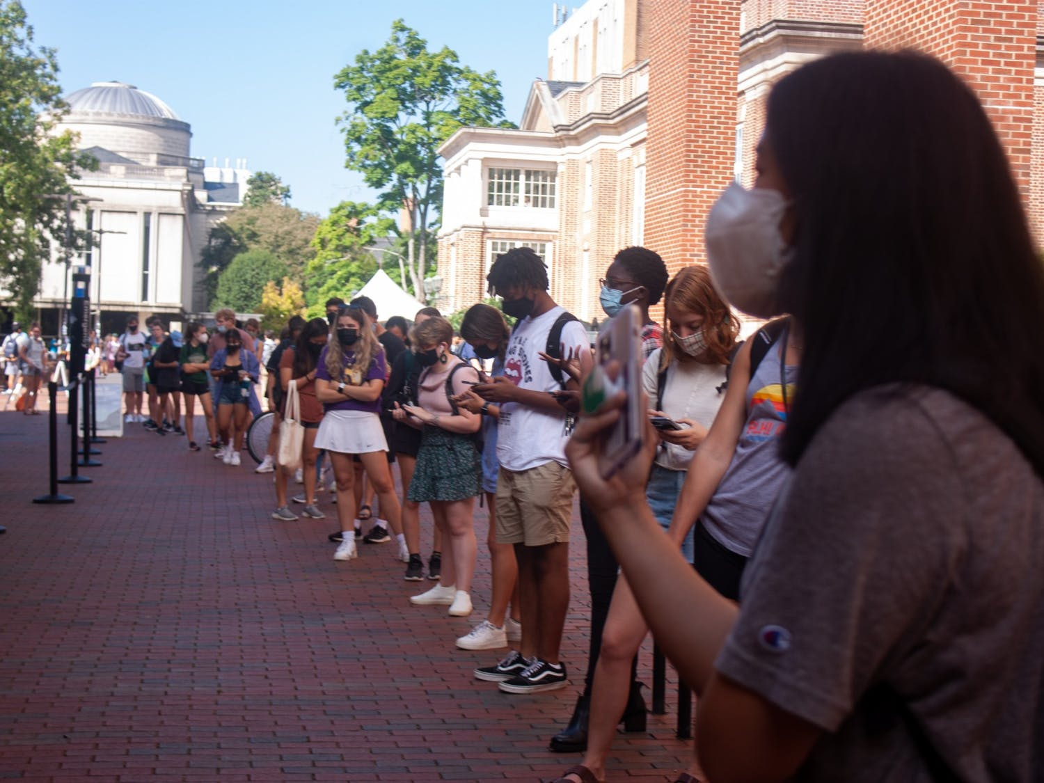 A long line forms Monday outside of the Student Union to get tested for COVID-19.