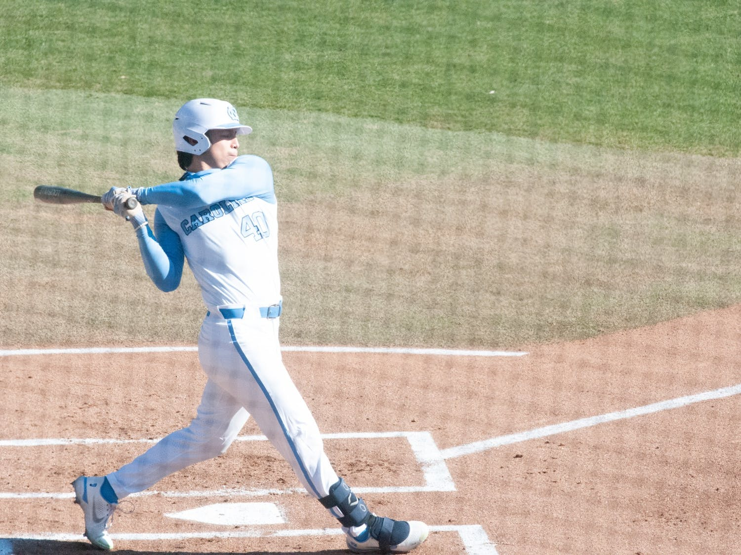 UNC sophomore Angel Zarate (40) swings at a pitch during UNC's 7-4 win over James Madison at Boshamer Stadium, Feb. 20, 2021.