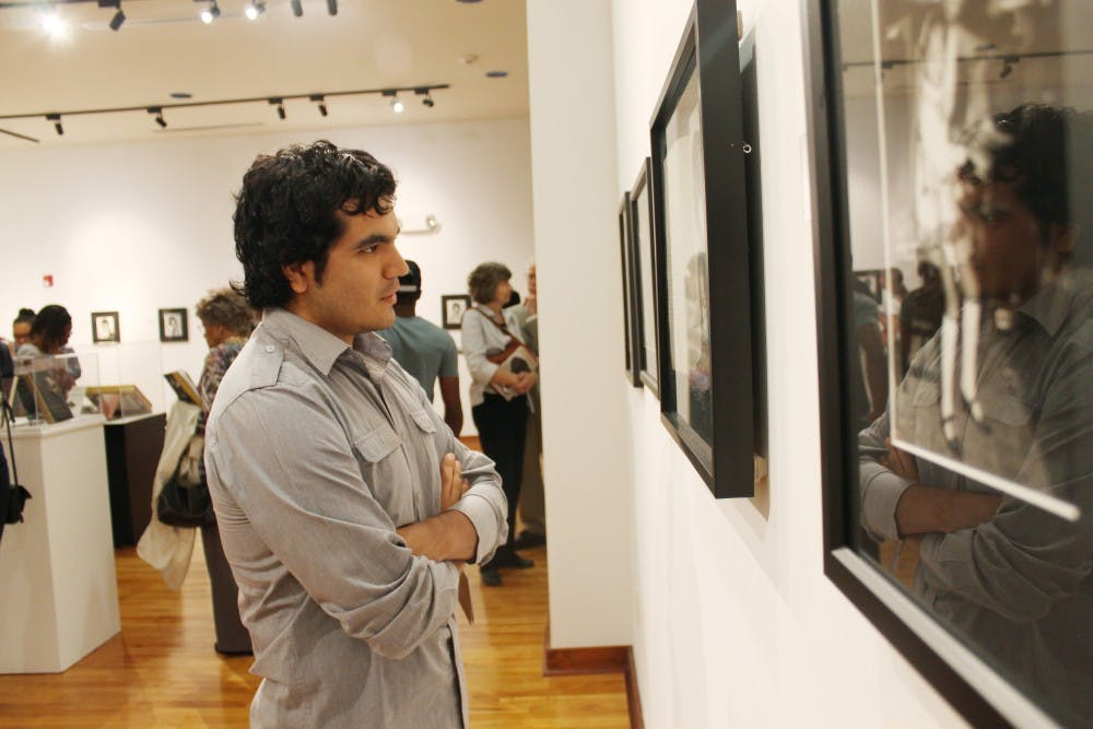 """Jose Torres-Don, a Carborro resident, came to see the different memorabilia at the """"Nina Simone"""" exhibit in the Stone Center."""