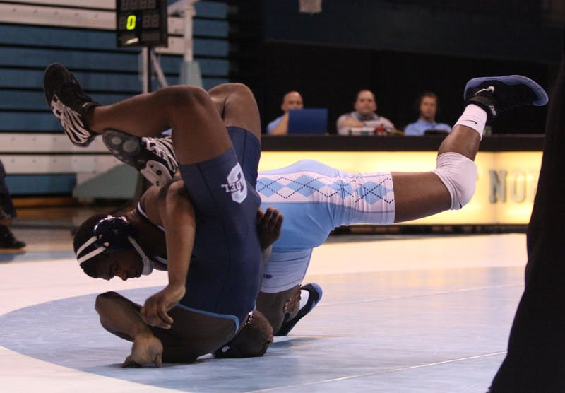 Thomas Ferguson earns a major decision against Kenneth Radford, bringing the Tar Heels within two points. The extra point Ferguson won with the major decision ended up being the difference in UNC's 19-18 victory.