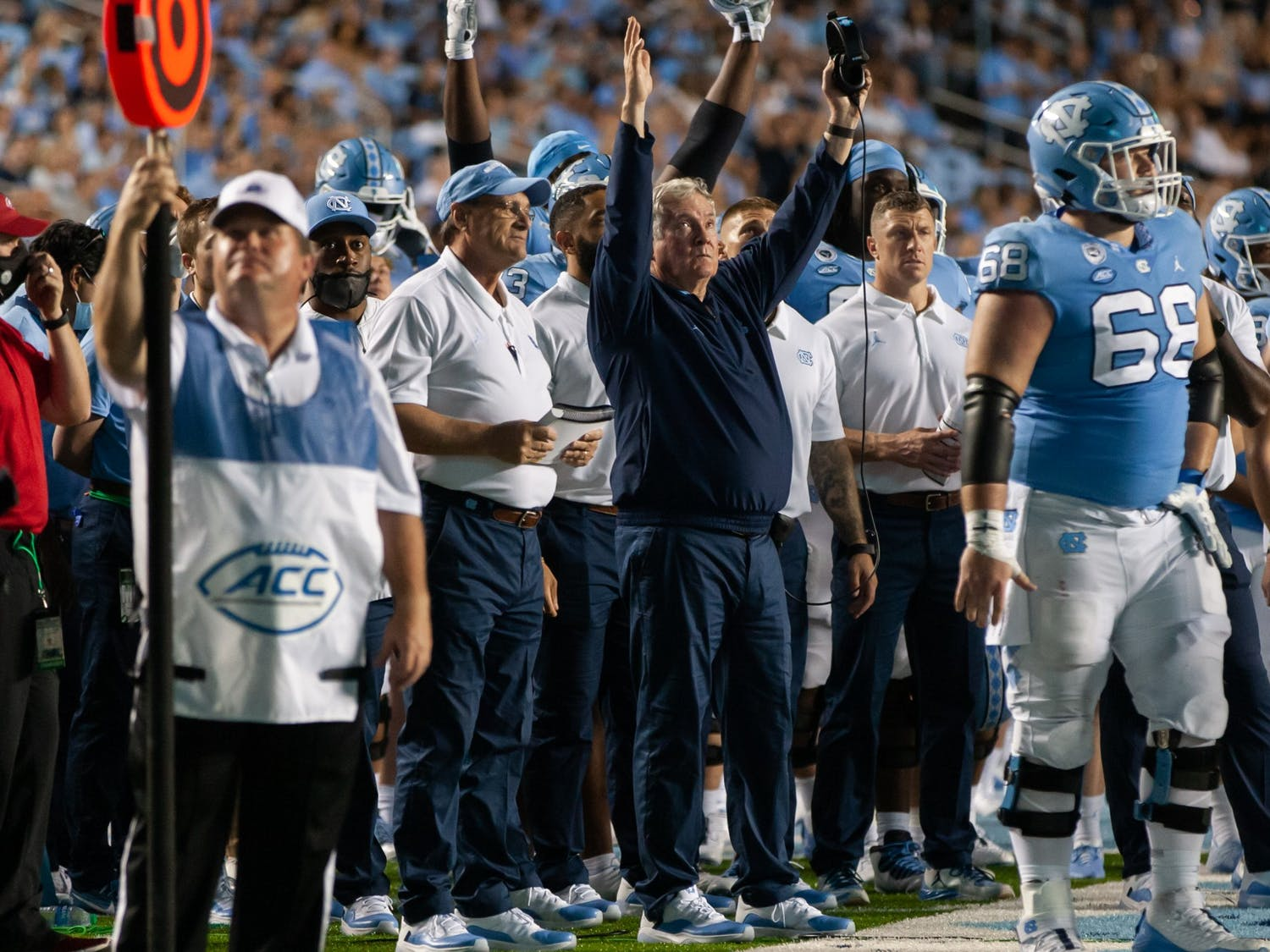 """UNC head coach Mack Brown throws up a """"goal"""" sign as the referees reviewed an instant replay during the Tar Heels' home matchup in Kenan Memorial Stadium on Saturday, Sept. 11, 2021 against the Georgia State Panthers. The Tar Heels won 59-17."""