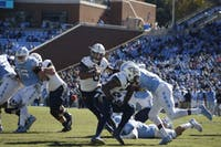 Georgia Tech quarterback Tobias Oliver (8) dodges UNC defenders during the home football game on Nov. 3, 2018. UNC lost 28-38.