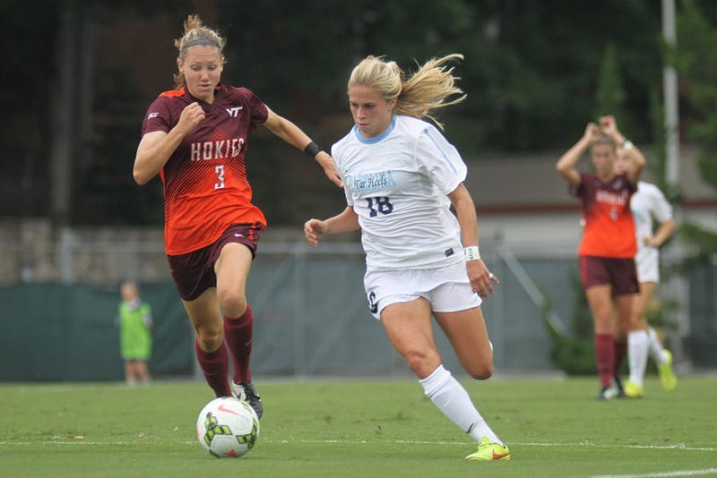 UNC midfielder Megan Buckingham (18) takes control of the ball.