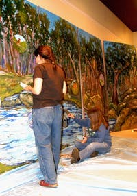 From left, Emily Weinstein and Dale Morgan work on a mural that will be shown at Earth Day festival. Courtesy of Dave Otto