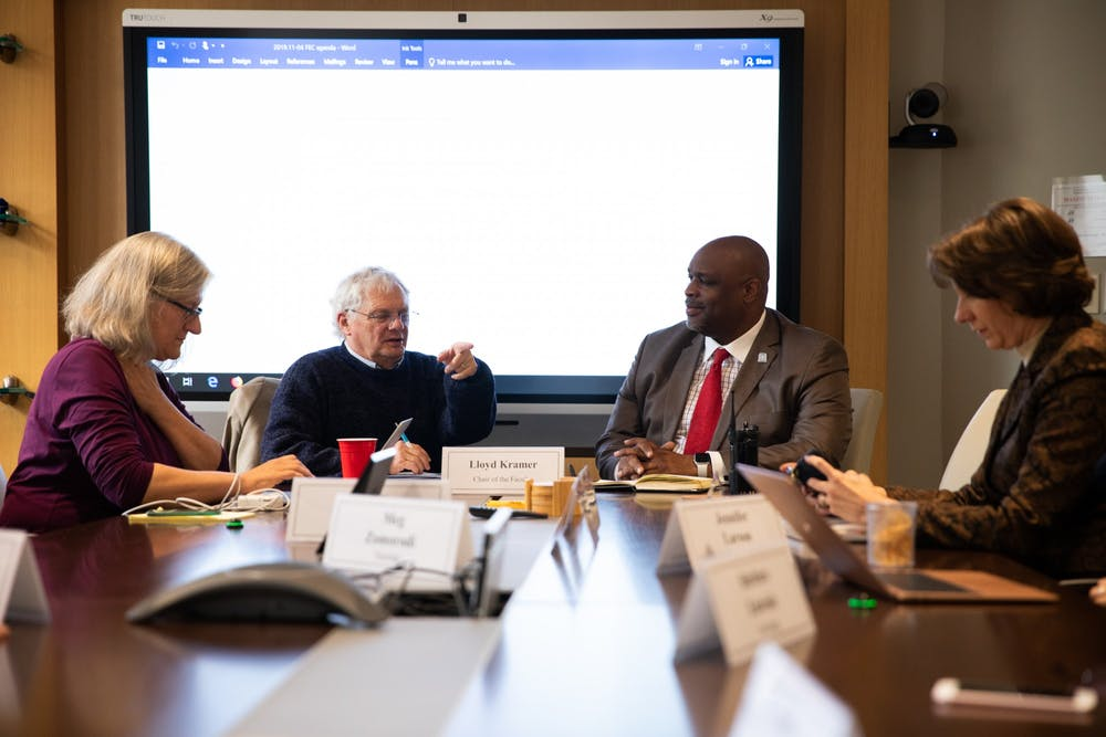 <p>(From left) Faculty Governance University Program Specialist Helena Knego, Chairperson Lloyd Kramer, UNC Police Chief David Perry and Joy Renner convene in South Building for a Faculty Executive Committee meeting to discuss campus safety measures in the wake of Perry's appointment as chief on Monday, Nov. 4, 2019. Perry emphasizes a need for the police to build a rapport with the community.</p>