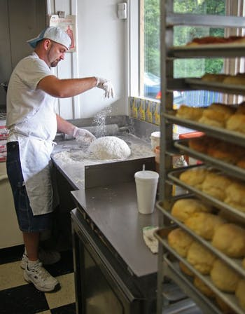 Brian foard makes biscuits at the sunrise Biscuit Kitchen on Tuesday. The kitchen's fried chicken biscuit was named best breakfast in the state.