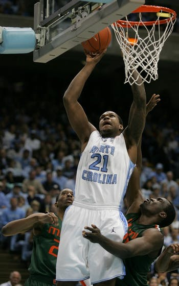 Senior Deon Thompson goes up for two of his 14 points against the Hurricanes. DTH Will Cooper