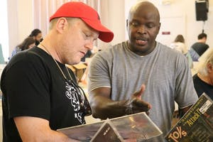 Tom Shaw (left) and Craig Williams (right) discuss records at the Carrboro Record and CD Show. Williams has been collecting records since he was in high school.