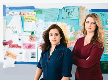 Andrea Pino (left) and Annie Clark in Los Angeles, in front of the map they use to keep track of their work. Photo courtesy of Jeff Lipsky.