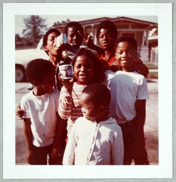 """Unidentified artist, American, """"Children with Photo in Hand."""" This is one of the photographs that will be featured at the """"Lost and Found: Stories for Vernacular Photographs"""" art exhibition. Photo courtesy of Eileen Hammond."""