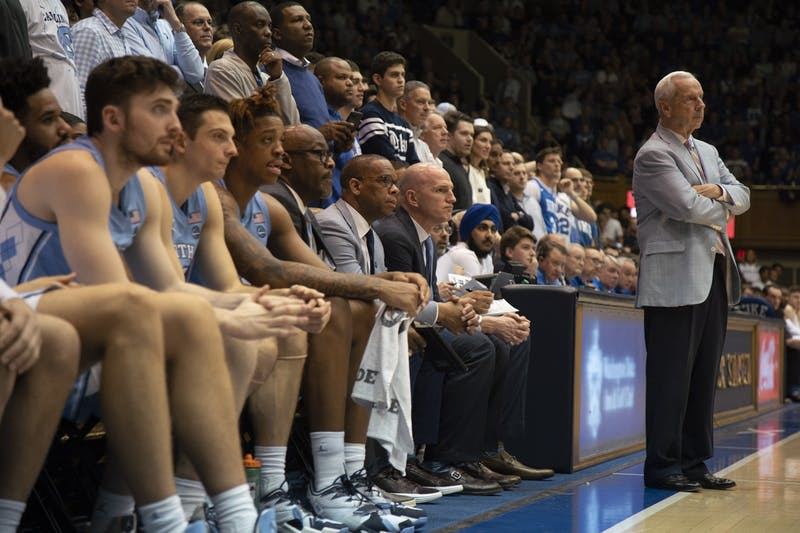 UNC men's basketball head coach Roy Williams and the bench observe the game between UNC and Duke. UNC lost 89-76 in Cameron Indoor Stadium on March 7, 2020.