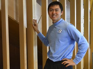 Larry Han, a senior (pictured), and UNC alumni Max Meunik are recipients of the prestigious Schwarzman Scholarship, allowing them to pursue a one-year Masters at Tsinghua University in Beijing, China.  Han works on global public health and infectious diseases, and plans to continue looking at how health policy affects hospital systems in China.