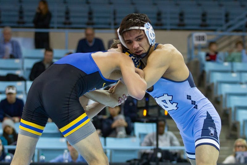 UNC's redshirt sophomore Jaime Hernandez wrestles Pittsburgh redshirt sophomore Micky Phillippi in Carmichael Arena on Friday, Feb. 14, 2020. North Carolina beat No. 9 Pittsburg 22-14.
