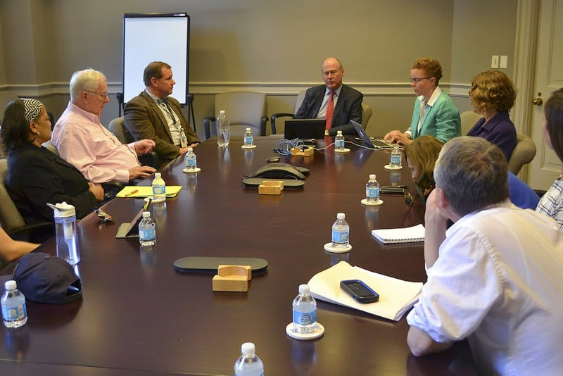 Faculty members gather Monday afternoon in South building for the Faculty Executive Committee meeting.  The meeting, which was led by Executive Vice Chancellor and Provost James W. Dean Jr, covered student binge drinking.