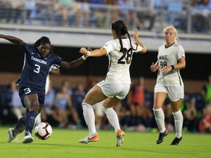 UNC redshirt senior foward Ru Mucherera (3) drives past Wake Forest players during a game in the UNC Soccer and Lacrosse Stadium on September 12, 2019. The Tar Heels beat the Demon Deacons 4-0.