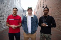 Seniors Nicho Stevens (left), Chris Coogan (middle), and Jemal Abdulhadi (right) of the UNC Student Hip Hop Organization (UNC SHHO) pose for a portrait on Friday, Jan. 18, 2018 in the alley next to Carolina Coffee Shop located on Franklin Street in Chapel Hill, North Carolina. Abdulhadi (right) discussed his experiences as a hip hop artist in lieu of the #MeToo movement which began in October of 2017.