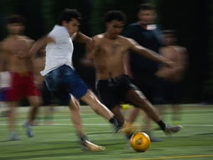 Hooker Fields hosts a wide variety of activities, including rugby, ultimate frisbee, and soccer. Here, two players fight for the ball during a pick-up soccer game on April 20, 2021.