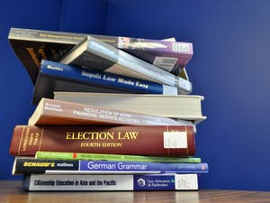 A stack of books sits on top of a table on the sixth floor of Davis Library on Monday, April 1, 2019.