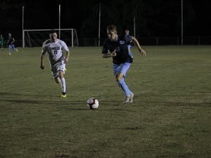 Midfielder Jack Skahan (8) competes for the ball against UNC-W Ben Fisher (11) during the men's soccer game on Tuesday, Oct. 2 2018 at WakeMed Soccer Park. Skahan scored the only goal of the game, for a final score of 1-0.