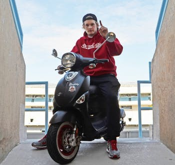 """Caleb Pressley and his scooter, """"Buddy Blackjack,"""" are the focus of the Crib Calls website, www.CalebPressley.com."""