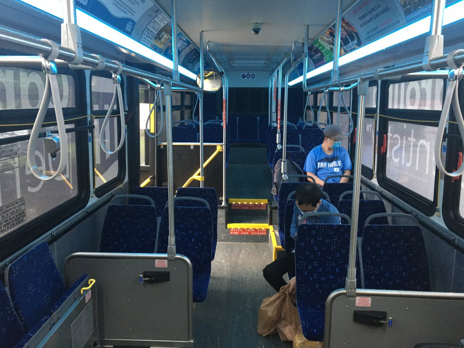 2 passengers with masks sit on a Chapel Hill Transit bus on the FG route. Photo Courtesy of Jeffrey Sullivan.