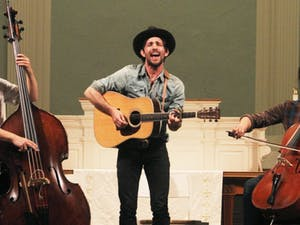 """Paul Defiglia, Scott Avett and Joe Kwon, from left to right, of the Avett Brothers perform at """"MElodies"""" to benefit Musical Empowerment."""
