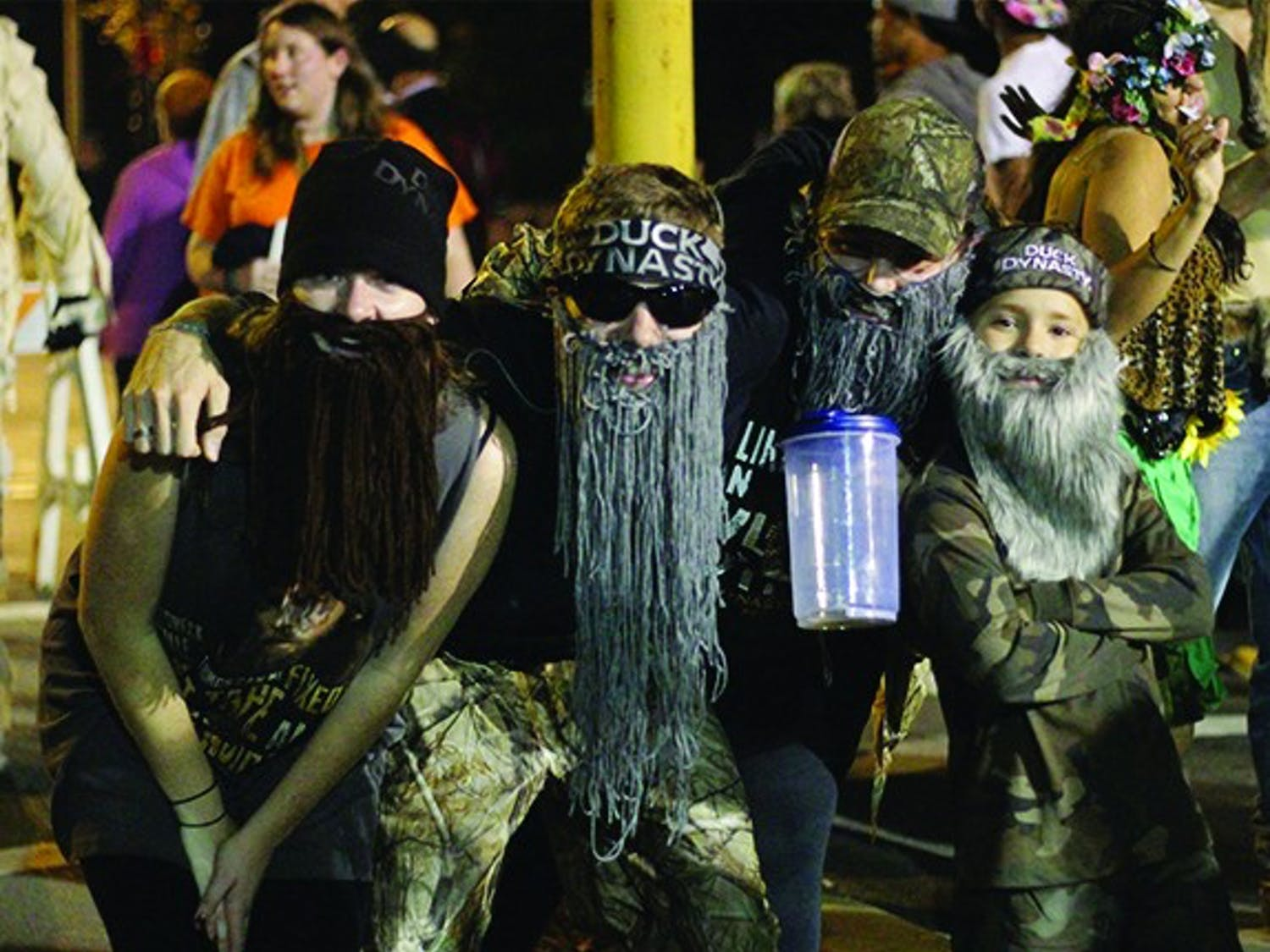 """Revelers swarmed the street October 31st to celebrate Halloween on Franklin Street. Around 300 officers were present to make sure the the fifth year of """"Homegrown Halloween"""" went off without a hitch in downtown Chapel Hill. One group decided to dress up as the popular sensation Duck Dynasty, complete with mop beards and a child."""