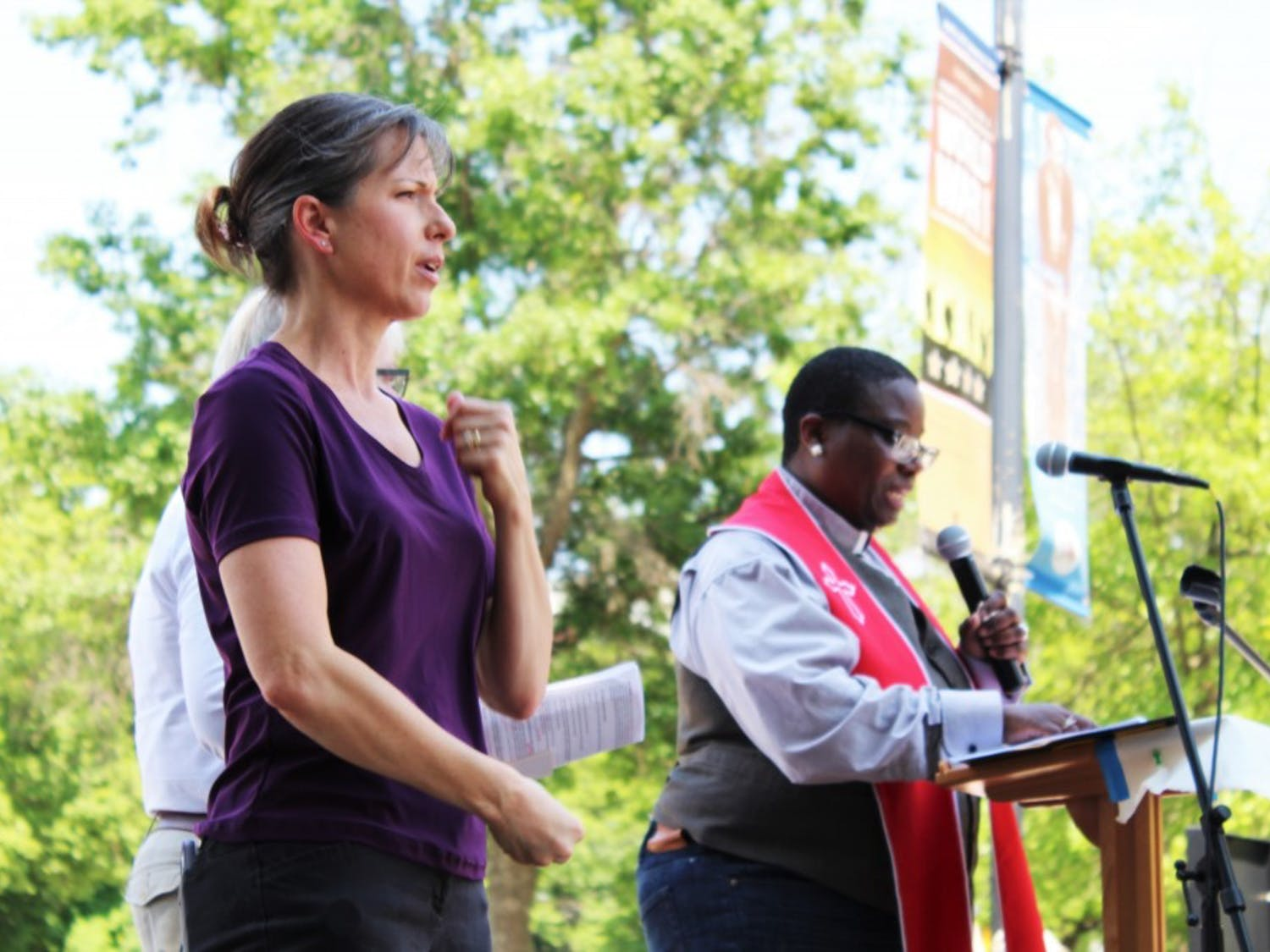 A sign language interpreter translates a speaker's words during the North Carolina Poor People's Campaign's protest on May 14.