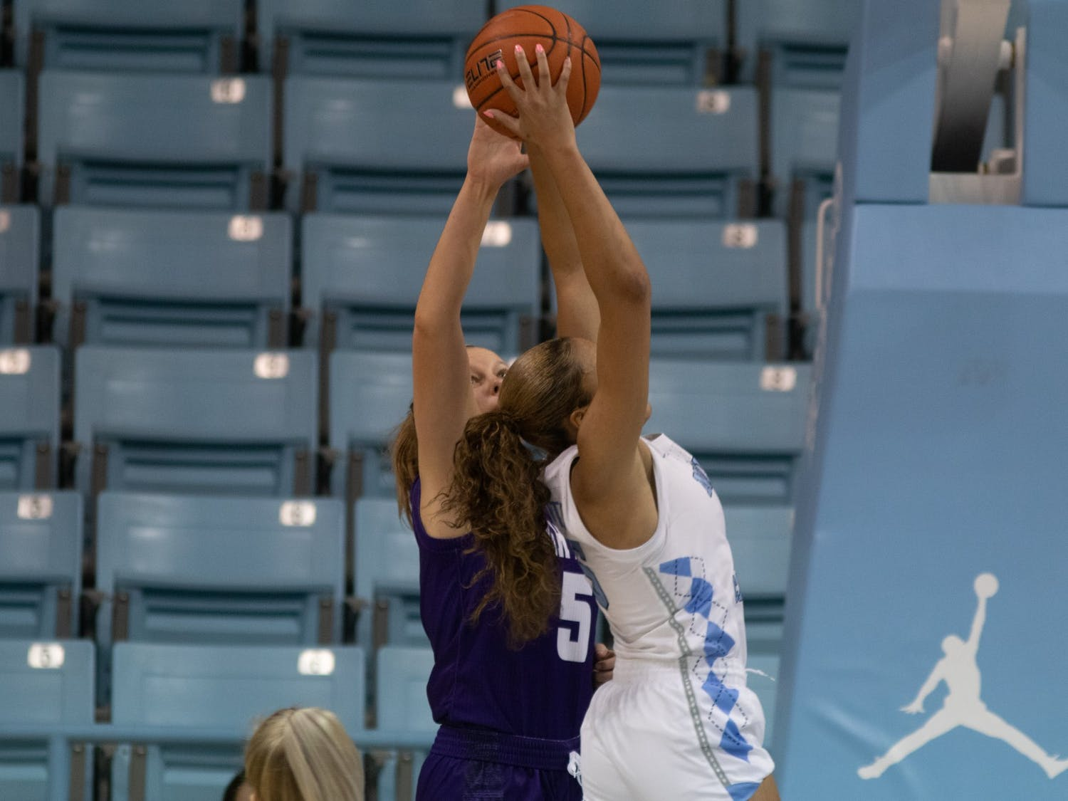 UNC graduate guard Stephanie Watts (5) corrals a rebound during Carolina's 95-70 win over High Point at Carmichael Arena, November 29, 2020.