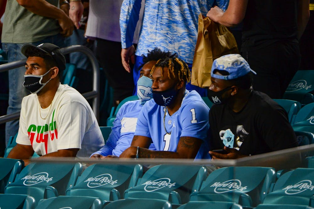 Some of UNC's players, such as graduate linebacker Chazz Surratt, junior wide receiver Dyami Brown, and senior running back Michael Carter, who chose to opt-out of the 2021 Capital One Orange Bowl watched the game against Texas A&M from the stands of Hard Rock Stadium on Saturday, Jan. 2, 2021. Texas A&M beat UNC 41-27.