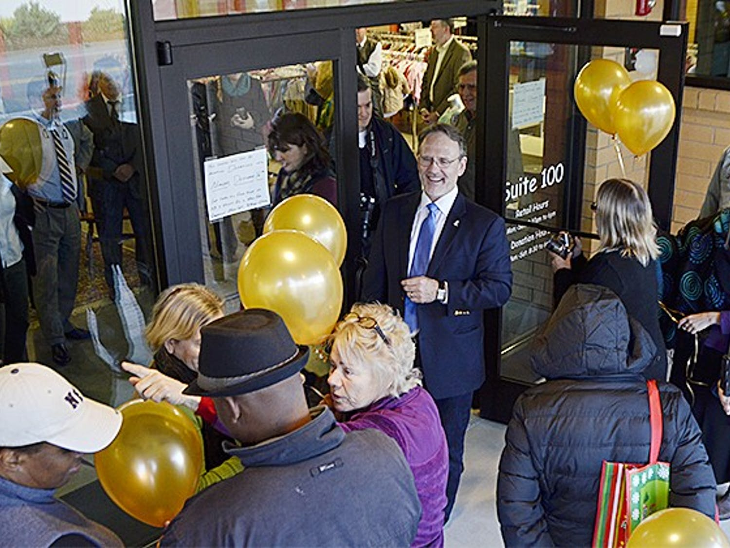 The PTA Thrift Shop opened on Monday morning with a ribbon cutting ceremony. Patrons lined up outside, eager to see the new building and the new stock.