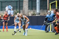 Senior Back Ashley Hoffman (13) of the UNC Field Hockey team defends the ball against Syracuse in a 5-1 win on Saturday, Sept. 29, 2018, at Karen Shelton Stadium in Chapel Hill, NC.
