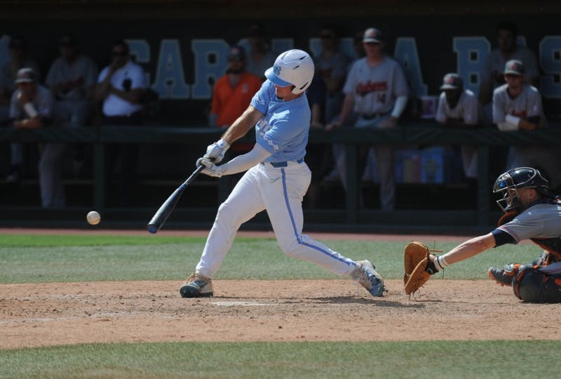 UNC junior outfielder Dylan Harris (3) hits the ball during the final game of the Chapel Hill Super Regionals on Monday, June 10, 2019. UNC lost to Auburn 14-7.