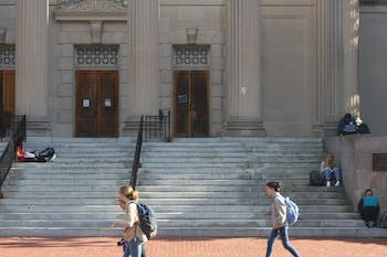 Students studying between classes on the steps of Wilson Library on Monday Oct. 22, 2018.