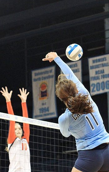 UNC senior Emily McGee spikes the ball Saturday against Virginia. McGee had 10 kills against the Cavaliers.