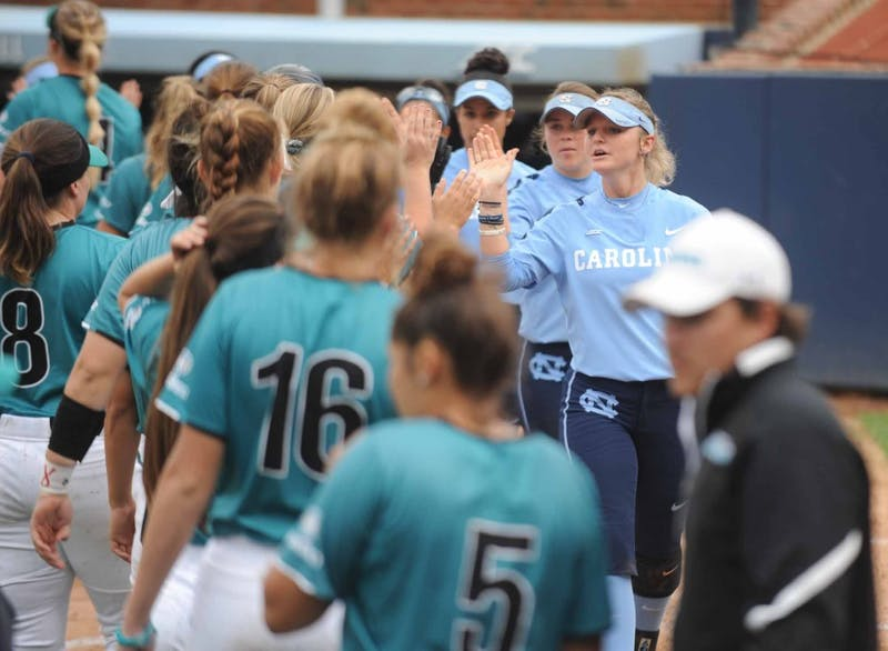 The UNC softball team, led by junior first base Campbell Hutcherson (5), high fives the Costal Carolina University team at the end of the game on Tuesday, April 9, 2019 at the Anderson Softball Stadium. UNC won 9-0 against Costal Carolina University.