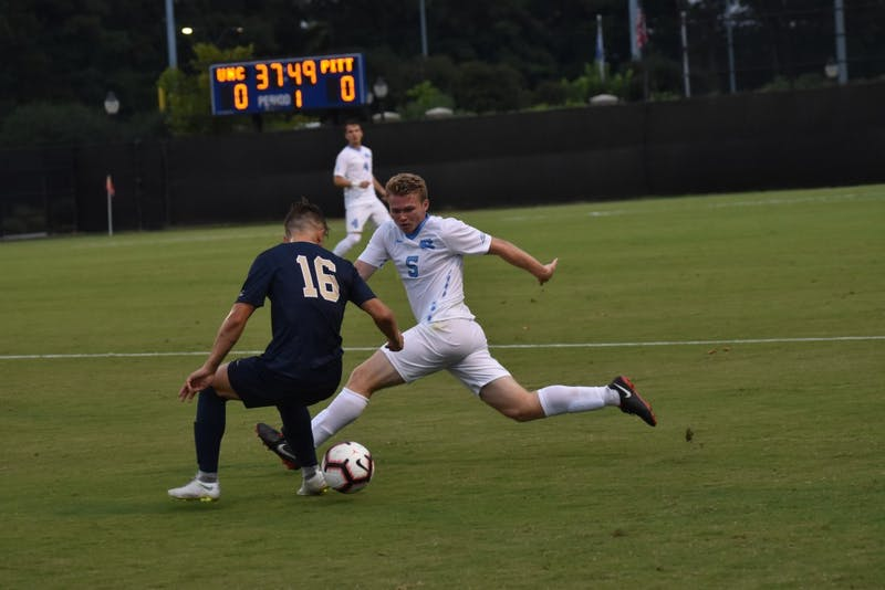 Center defender John Nelson (5) fights for the ball against defender Nyk Sessock (16) during Saturday night's game against Pittsburgh at Koskinen Stadium.