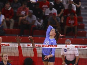 Julia Scoles (12) goes up for one of her many kills during the game against N.C. State.