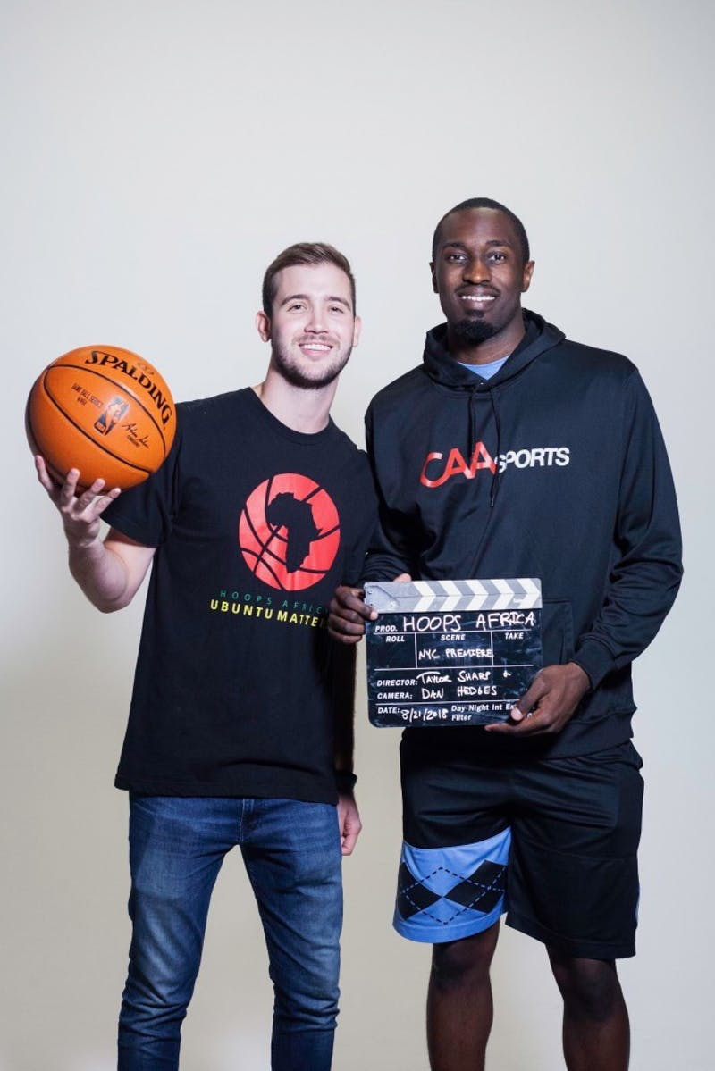 Filmmaker Taylor Sharp poses with former North Carolina basketball forward, Theo Pinson.