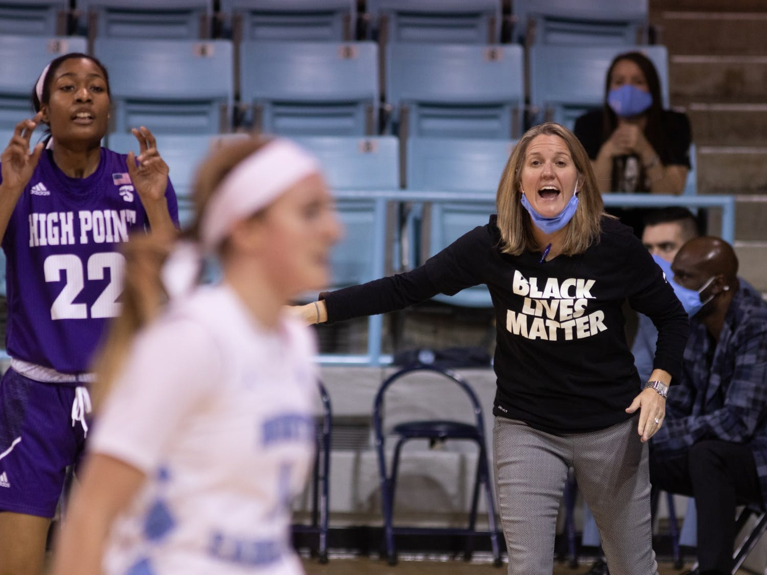UNC women's basketball coach Courtney Banghart cheers on her team during a game against High Point in Carmichael Arena on Sunday, Nov. 29, 2020. UNC beat High Point 95-70.