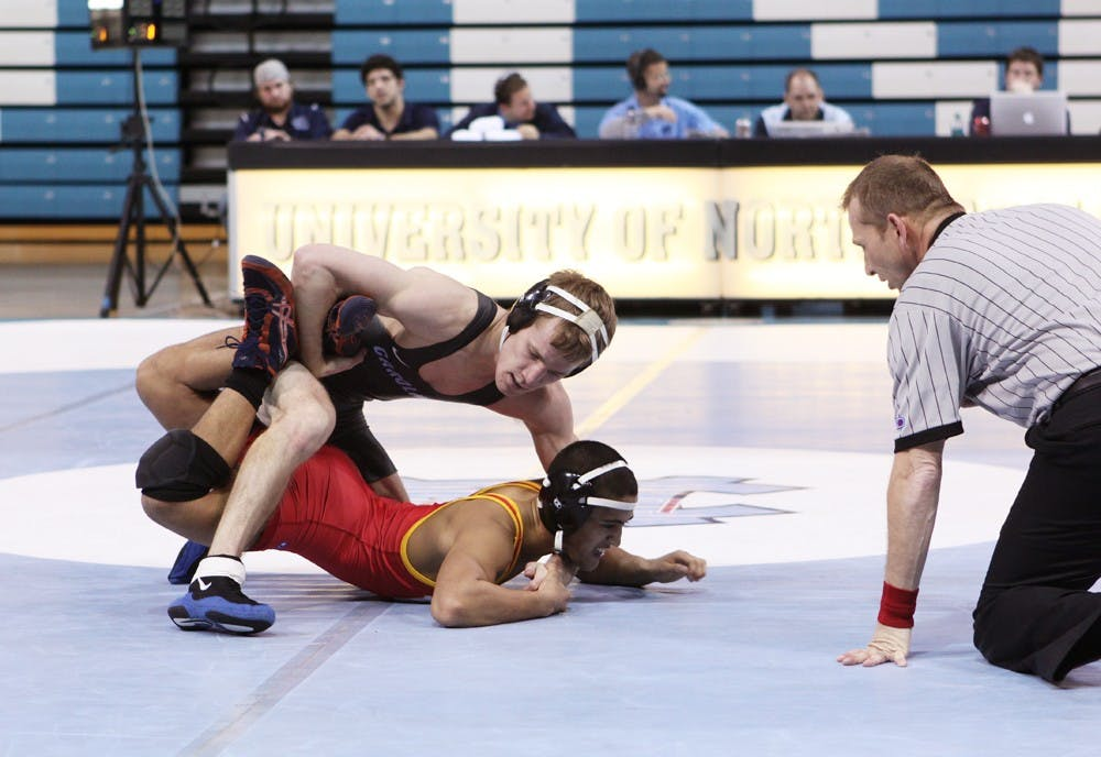 UNC wrestling beats VMI easily