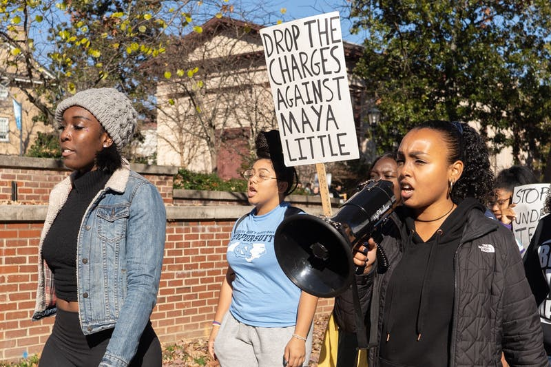 UNC's Black Student Movement, Black Congress and student and local activists convened in McCorkle place before marching to South Building on Thursday, Dec. 5, 2019 at 1 p.m. The activists protested the University giving $2.5 million and Silent Sam to the Sons of Confederate Veterans.